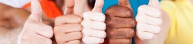 group of multiracial friends thumbs up